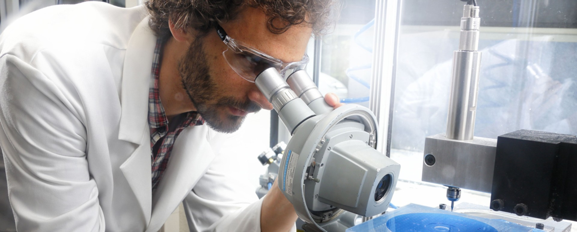 Lab technician performing a visual inspection